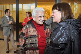 Sr. Marie-Julianne Farrington, facing, chats with guest Janet Windsor during the reception.