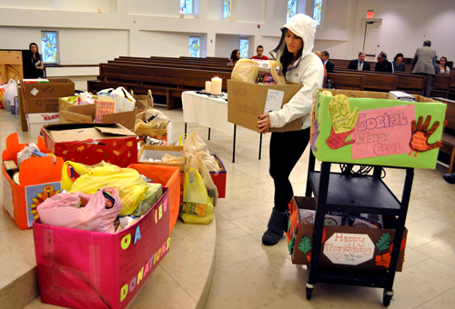 Sophomore Laura DeFilippis drops off food donations in the Chapel just prior to the Interfaith Service.
