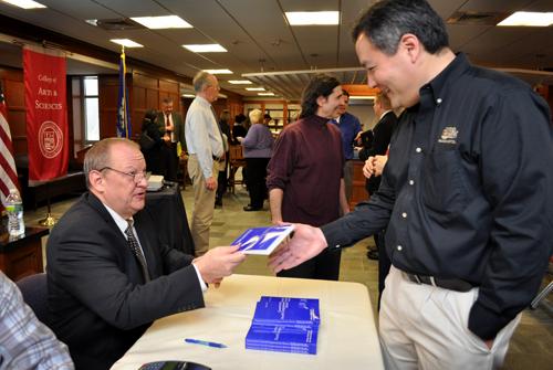 Dr. Gary Rose signs his book for Saburo Usami