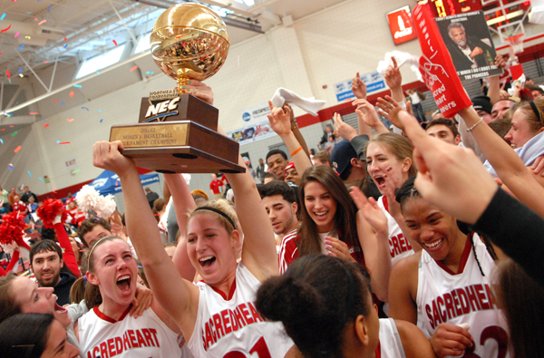 The Women's Basketball team celebrates after winning the NEC Championship last Sunday.