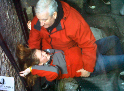 Freshman trombone player Winnie Maloney getting some help kissing the Blarney Stone.