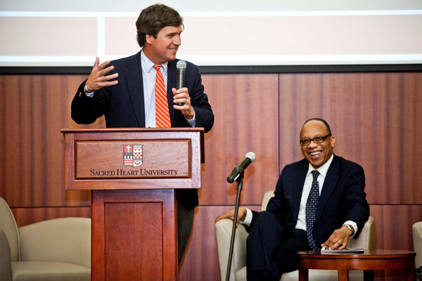 Tucker Carlson, left, and Eugene Robinson