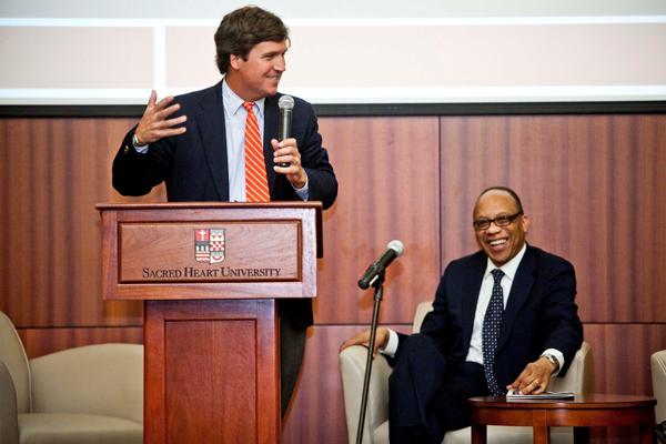 Tucker Carlson, left, and Eugene Robinson