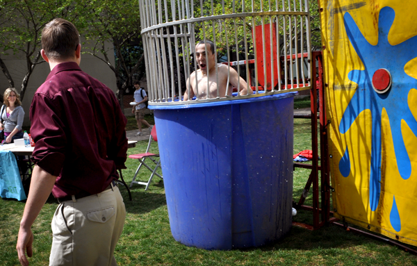 At the dunk tank fundraiser, Mike Wright '13, left, dunks Brian Harrison '12.