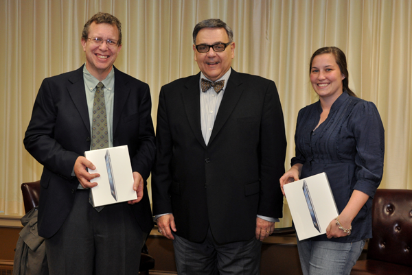 Religious freedom essay contest winners David Hill, left, and Katie Nichols with President Petillo