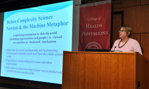 Dr. Anne Barker speaks on Complexity Science during the Academic Research Showcase.