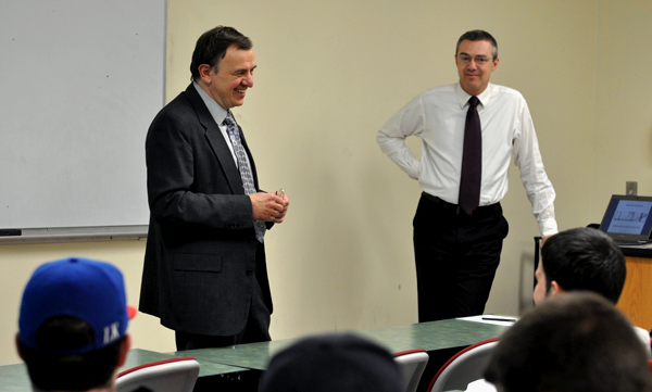 Professor Lucjan Orlowski, left, introduces EvženKočenda