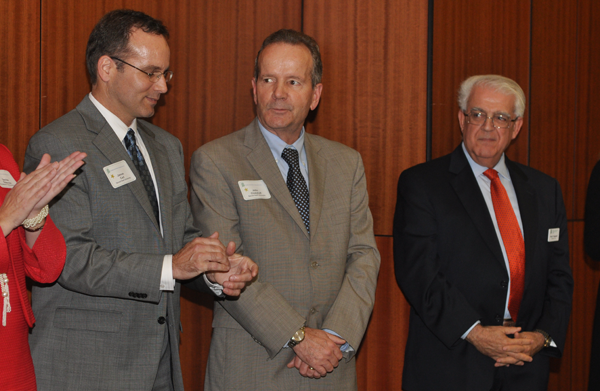 Deans Jim Carl, left, and John Chalykoff are honored at the BRBC event. At right is BRBC President and SHU alumnus Paul Timpanelli.