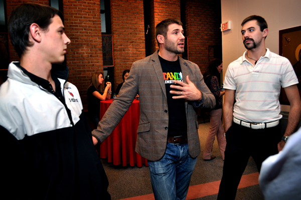 Ben Cohen, center, meets with students before his talk.