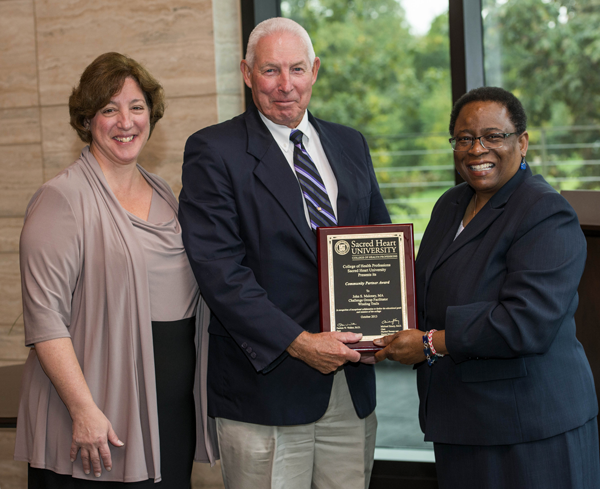 CHP Community Partner Award - from left are Professor Donna Bowers, John Maloney and Dean Patricia Walker.