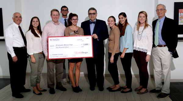 Heartfelt Designs presents check to Volunteer Programs and Service Learning