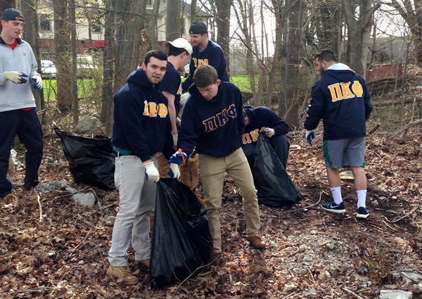 Pi Kappa Phi clean-up behind Roncalli