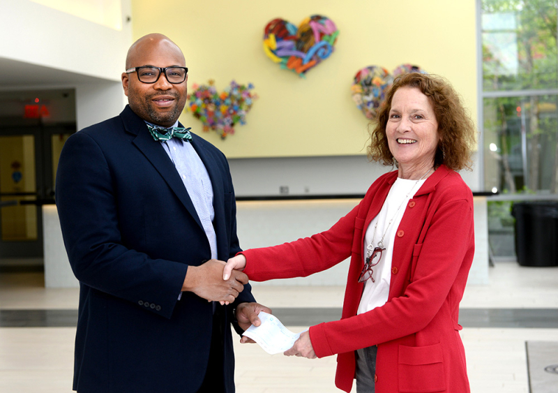 Caesar Irby, DPM, with biology instructor Marilyn Moss, MD